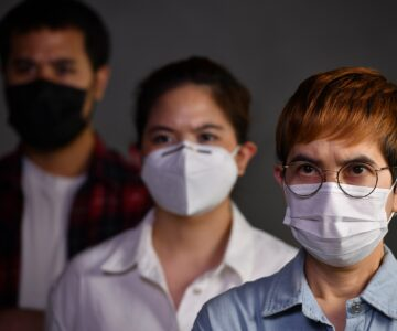People wearing surgical masks looking worried concerned with pandemic outbreak Coronavirus (covid-19)situation
